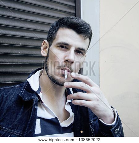 middle age man smoking cigarette on backjard, stylish tough guy, lifestyle people concept close up