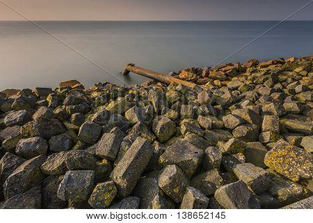 Waste Pipe Into Lake  IJsselmeer At Sunrise