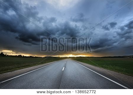 Classic Scene Of A Highway In Rural Area At The Sunset