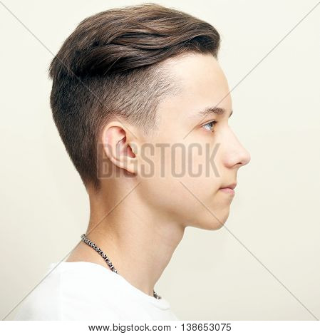 Young man profile face over gray background