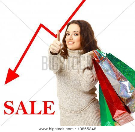 Portrait of an young woman holding several shoppingbag
