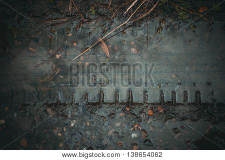 Top view on mud in dark rural road track