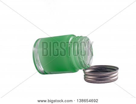 Close up of open container of ointment or cream on white background