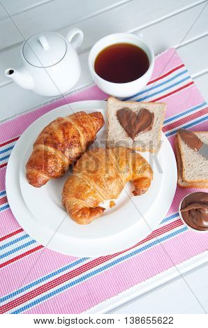 Sunday breakfast. Croissants with tea toast and peanut butter.