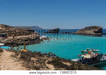 June 2016: Blue Lagoon Bay: Gozo, Malta: a popular tourist destination on sunny days