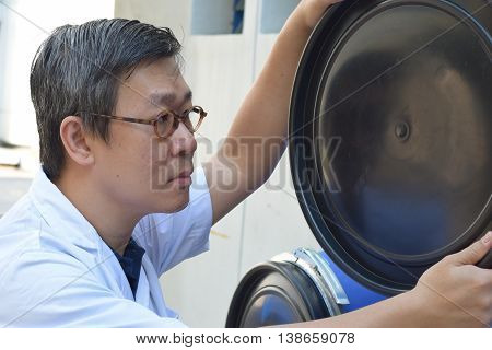 A QC Engineer inspecting the barrel for any defects