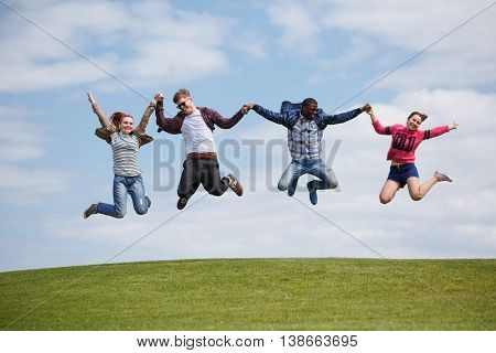 Picture of men and women enjoying summer weather and shining sun. Best friends having rest outdoors. People spending free time on picnic.
