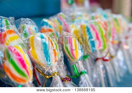 Close-up detail of colorful striped lollipops ready to be shared on Halloween.