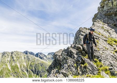 Mountaineer On The Ridge.