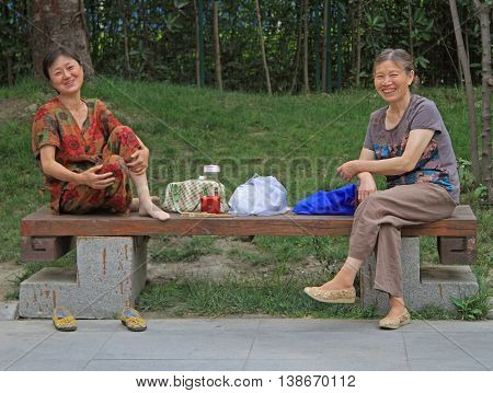 Two Women Are Resting In Park Of Chengdu, China