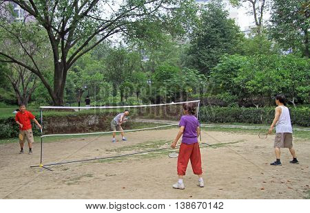 Chengdu China - June 16 2015: chinese people are playing badminton in park of Chengdu Russia