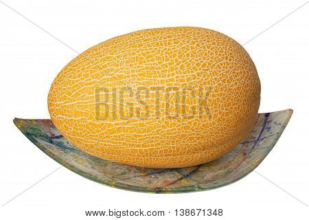 The muskmelon on the glass plate isolated on white background