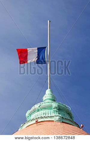 French Flag Half Staff at Flagpole Mourning
