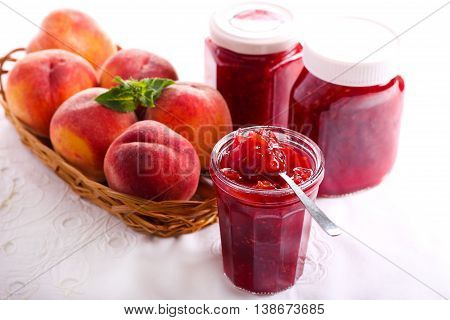 Peach and raspberry homemade jam in jars