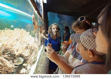 Sochi, Russia - June 27, 2014, Visitors to the aquarium stand at the aquarium with marine life
