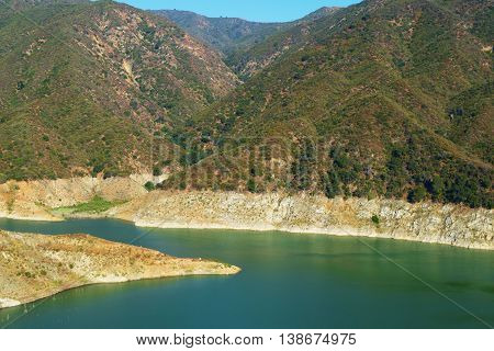 Low water levels caused by the California Drought taken at Morris Reservoir in the arid San Gabriel Mountains, CA