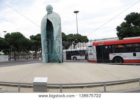 Rome, Italy. Conversazioni Pope John Paul II statue at Termini train station. A tall bronze sculpture, with a clock in the place of a body, dedicated to Pope John Paul II.