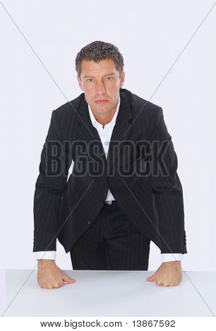 Young serious worried businessman isolated over white background