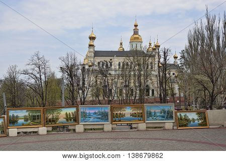 KHARKIV UKRAINE - APRIL 26 2015: Improvised exhibition of works by an unknown artist near the Pokrovsky monastery in Kharkiv permanent vernissage of street artists