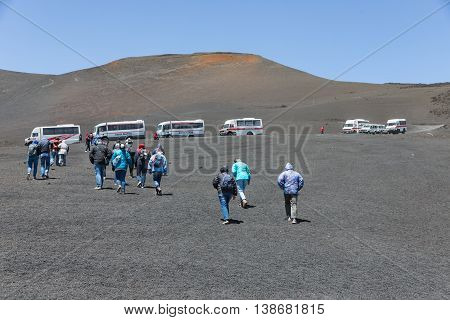 MOUNT ETNA ITALY - MAY 23: Landrovers ands tourists visiting the vulcano of Mount Etna on May 23 2016 at the island Sicily Italy