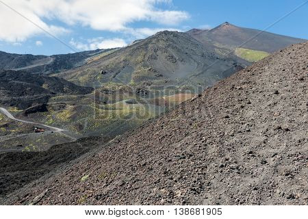 Bare slopes of Mount Etna covered with ashes and stones Sicily Italy