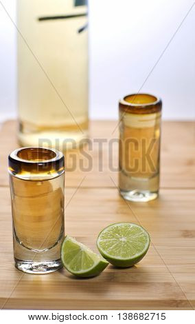 a small sip of tequila with lemons