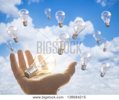 Image concept of brainstorm. The lamp lit in hand means a great idea.