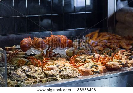 Assortment Seafood In Showcase At Restaurant