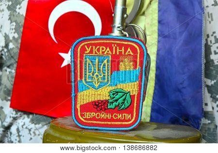 ILLUSTRATIVE EDITORIAL.Chevron of Ukrainian army.Background -Flag Ukraiine and Turkey.Strategic partnership.July 16 ,2016 in Kiev, Ukraine