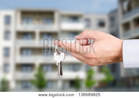 Man Hand Holding Keys To New House
