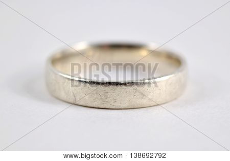 Scuffed and scratched silver ring isolated on white background