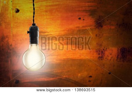 Idea  Concept -  Bulb On The Grunge Background