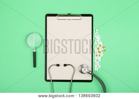 Doctors Workplace - Medical Tablet, Stethoscope, Pills And Magnifying Glass