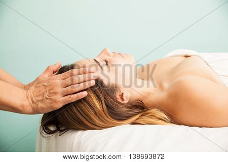 Woman In A Reiki Therapy Session