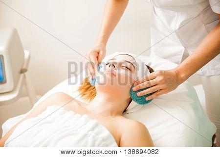 Young Woman Finishing A Facial Treatment
