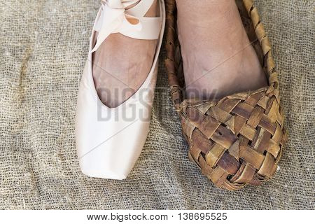 Feet girl in Ballet shoes and Bast shoe on canvas
