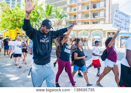 Honolulu, HI. USA  July 9, 2016  Approximately fifty or so Black Lives Matter protesters hit the strip in Waikiki on Saturday afternoon with chants of
