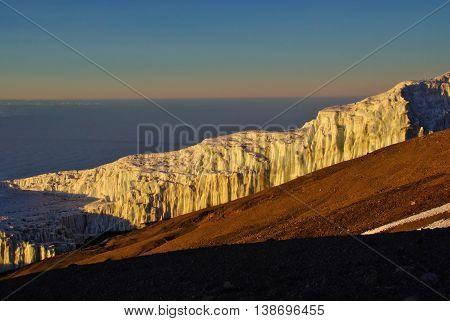 Kilimanjaro glacier near the crater ridge, sea of clouds behind