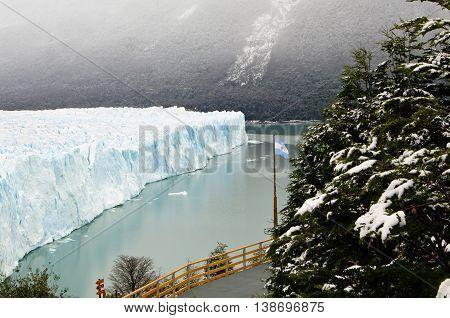 Perito Moreno glacier and Argentina flag, Patagonia