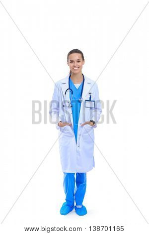 Beautiful young woman in white coat posing with hand in pocket.
