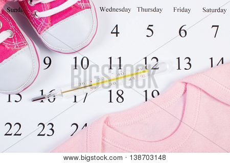 Thermometer And Clothing For Newborn On Calendar, Expecting For Baby
