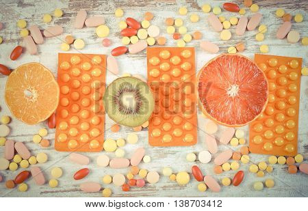 Vintage Photo, Natural Fruits And Pills, Choice Between Healthy Nutrition And Supplements