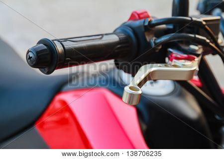 Close up of racing motorcycle handlebar and brake lever.