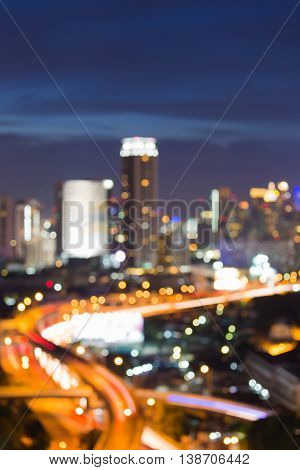 Abstract blurred lights city and highway intersection at twilight