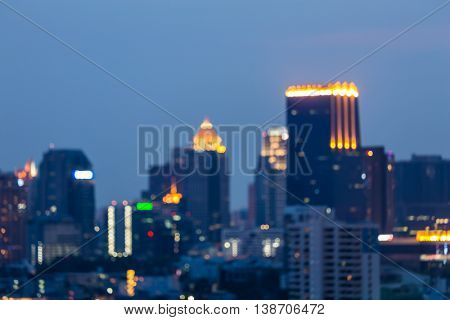 Night blurred bokeh lights, office building abstract background