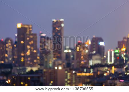 Blurred bokeh light night view, city and office, abstract background