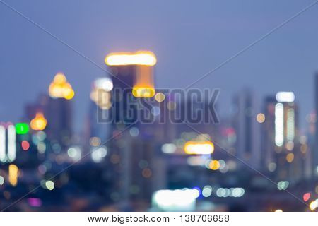 Abstract blurred bokeh light background, city and office tower at twilight