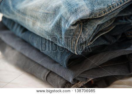 Pile of blue jeans close upblue jeans texture