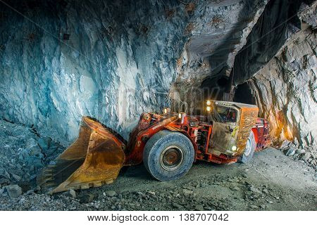 Working inside gold mine tunnel. Gold mining.