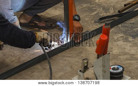 Worker Without Welding Protective Gloves Welding Metal - Conditions Hazardous Working.